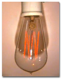 Early light bulb with tungsten filament.