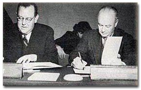 The late Mr. Trygve Lie, Secretary General of the United Nations (left), and Dr. Brock Chisholm, Director General of the World Health Organization, signing the protocol regarding the entry into force of the agreement between the UN and WHO to bring the Organization into relationship with the United Nations.