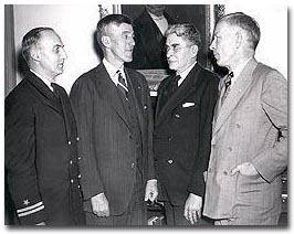 Lt. Edward Furber, Gov. Saltonstall, Dr. Eliot, and William Roger Greeley at an annual meeting of the Layman's League (1942, courtesy of the Boston Public Library, Print Department)