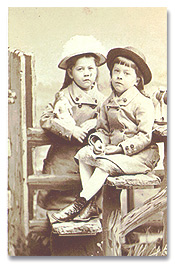 HWF, seated, age 6 with his twin sister, Frances Eliot Foote.