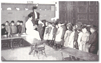 The superintendant of nurses, Ms. Lina Rogers, inspecting school children.