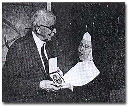 Melcher receives Regina Medal