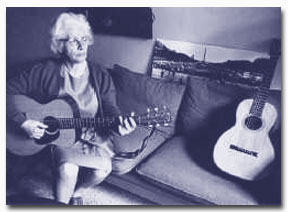 Malvina Reynolds playing guitar