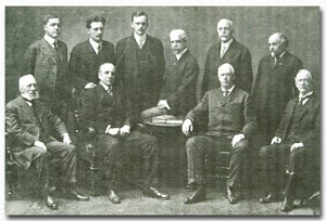 Eliot seated second left with staff at 25 Beacon Street