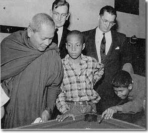 A Buddhist monk visits the Columbia Heights Boys Club, 1955.