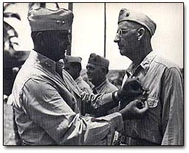 Receiving the Bronze Star for service on Peleliu during World War II.