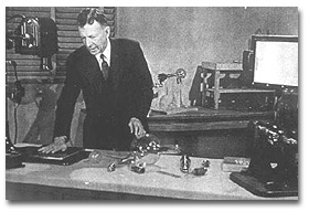William Coolidge shown in his laboratory working with his X-ray tube.