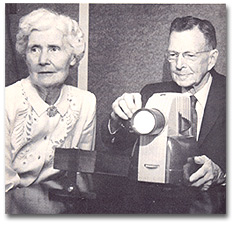 Dr. and Mrs. Coolidge viewing pictures taken on their travels.
