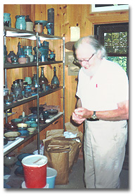 Arthur in his pottery studio.