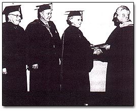 Receiving the degree of Honorary Doctor of Divinity from Meadville/Lombard Theological School, Chicago, January 16, 1962. Left to right: the Rev. Edwin Theophil Buehrer, James K. Killian, Jr., Sophia Lyon Fahs, Dr. Malcolm R. Sutherland, President.