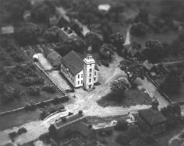 The Third Meeting House and the Court House (right) are shown in the Old Cambridge diorama at the Widener Library.